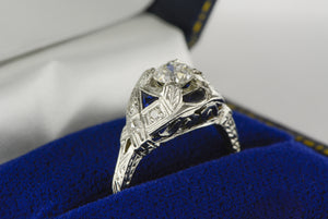 1920s Edwardian / Art Deco Platinum Engagement Ring with .60 Carat Old European Cut Diamond Center, Natural Sapphire and Single Cut Diamond Accents