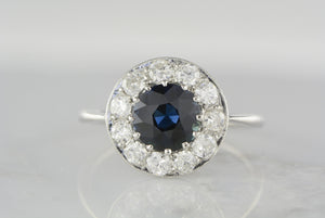 1.50 Carat Natural Sapphire in Art Deco Platinum Ring with Twelve (.84 ctw) Transitional Cut Diamond Halo