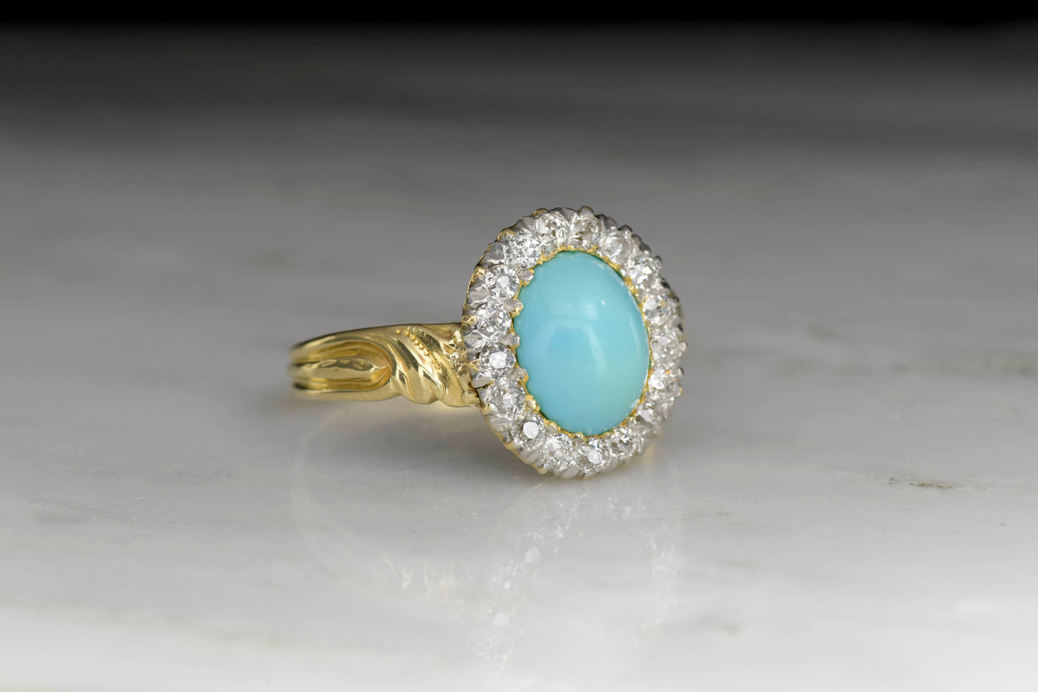 Antique Late Victorian Old Mine Cut Halo Ring with a Cabochon Cut Turquoise Center