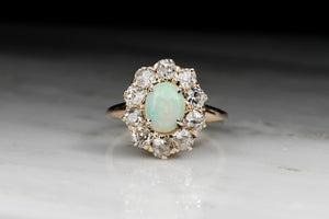 Antique Victorian Cabochon Cut Opal and Old Mine Cut Diamond Cluster Engagement Ring