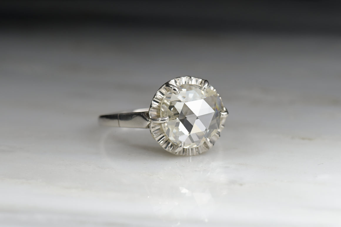 Antique Rose Cut Diamond (3.00 Carat Spread) in an Edwardian Engagement Ring with a Fluted Halo