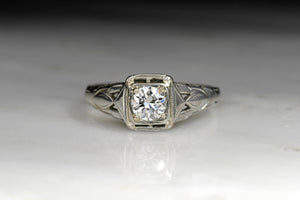 Late Art Deco / Retro Engagement Ring with a Round Brilliant Cut Diamond Center