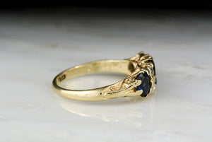 Antique Late Victorian Oval Cut Sapphire and Diamond Ring in Yellow Gold