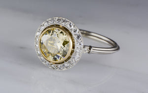 1.36 Carat Fancy Light Yellow Old European Cut Diamond in Art Deco Platinum Engagement Ring with .35 ctw Diamond Accents