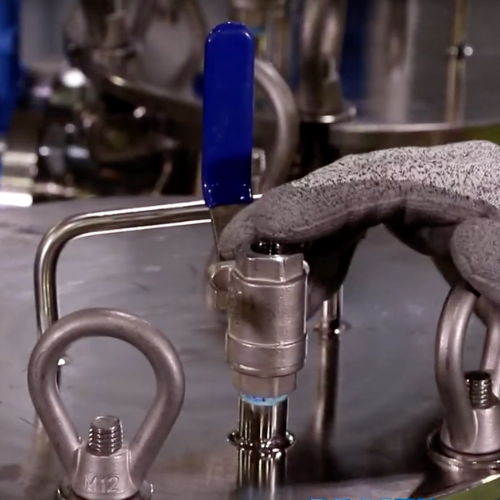 Open the sample port at the top of the housing to allow air flow for draining