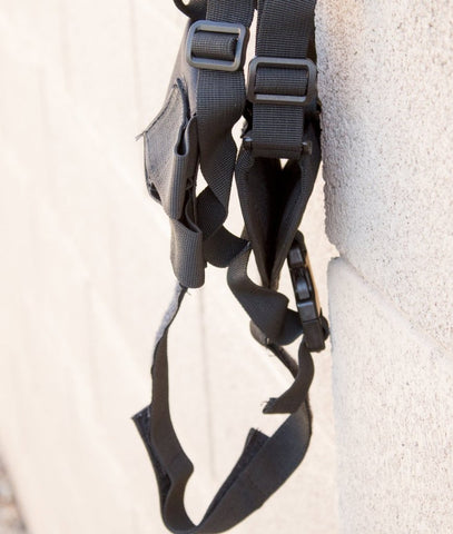 shoulder holster on a wall