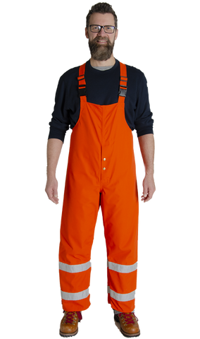 Image of MWG GLENGUARD laminated rain resistant overall. MWG GLENGUARD rain resistant overall is bright orange in colour with silver reflective tape on both legs. Overall is made with inherent flame-resistant fabric.