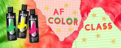 "3 bottles of Arctic Fox Hair Color dye on top of a green, yellow, and pink swatch of hair. The swatch of hair is overlaid with notebook paper that says ""AF Color Class"" with stars around it"