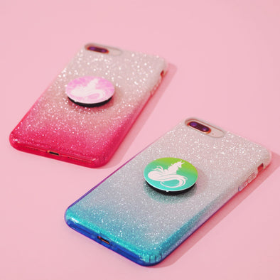 To the left is a pink sparkly phone case with a pink AF Pop Socket on it. On the right is a blue sparkly phone case with a blue AF Pop Socket on it.