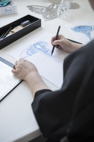 Zoe Bradley creating initial sketch for Harrods