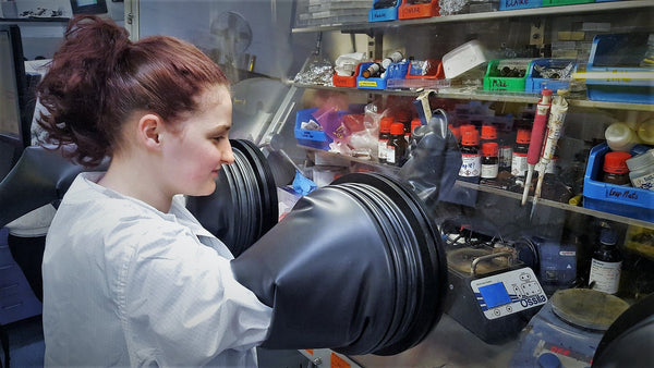 Ossila PhD student, Mary, using a glovebox
