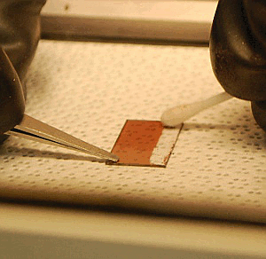 Wiping cathode clean with solvent