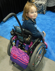 Young Wheelchair User Loves Her HDS Medallion Princess Damask Bag