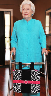 A senior woman using an HDS Medallion mobility bag as a fashionable accessory for her walker.
