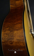 Hewett quilted Mahogany D guitar side close up