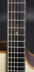 Lowden guitar fretboard with purfling lines