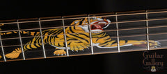 Leach guitar with tiger fretboard inlay