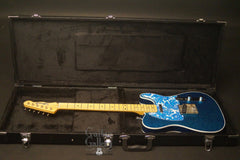 Crook T-style electric guitar inside case