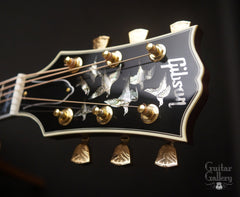 Gibson Doves in Flight guitar headstock with 7 engraved doves