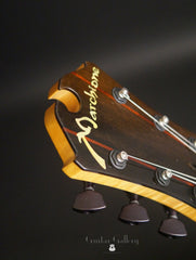 Marchione semi-hollow deluxe archtop builder logo