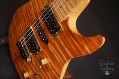 Brian Moore custom electric guitar koa top