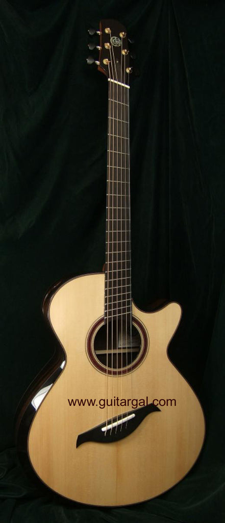 Berkowitz Guitar: Old Black Brazilian Baritone Fan Fret