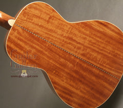 Square Deal guitar beeswing mahogany back
