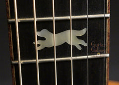 Running Dog guitar logo