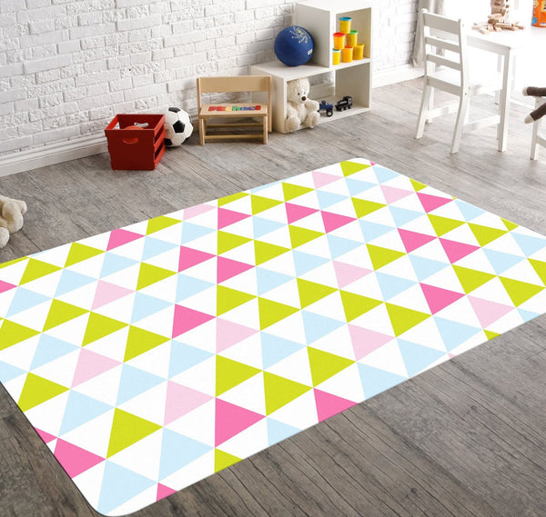 A geometric rug with pink, yellow and pale blue triangles. This nursery rug with a dynamic design will liven up your child's nursery or your teenager's room in an instant.