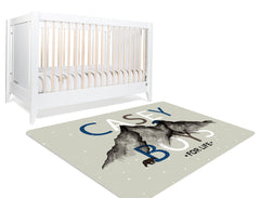 Gray brown blue nursery rug in front of white crib at an angle. Starting at $89.99 + Free US shipping