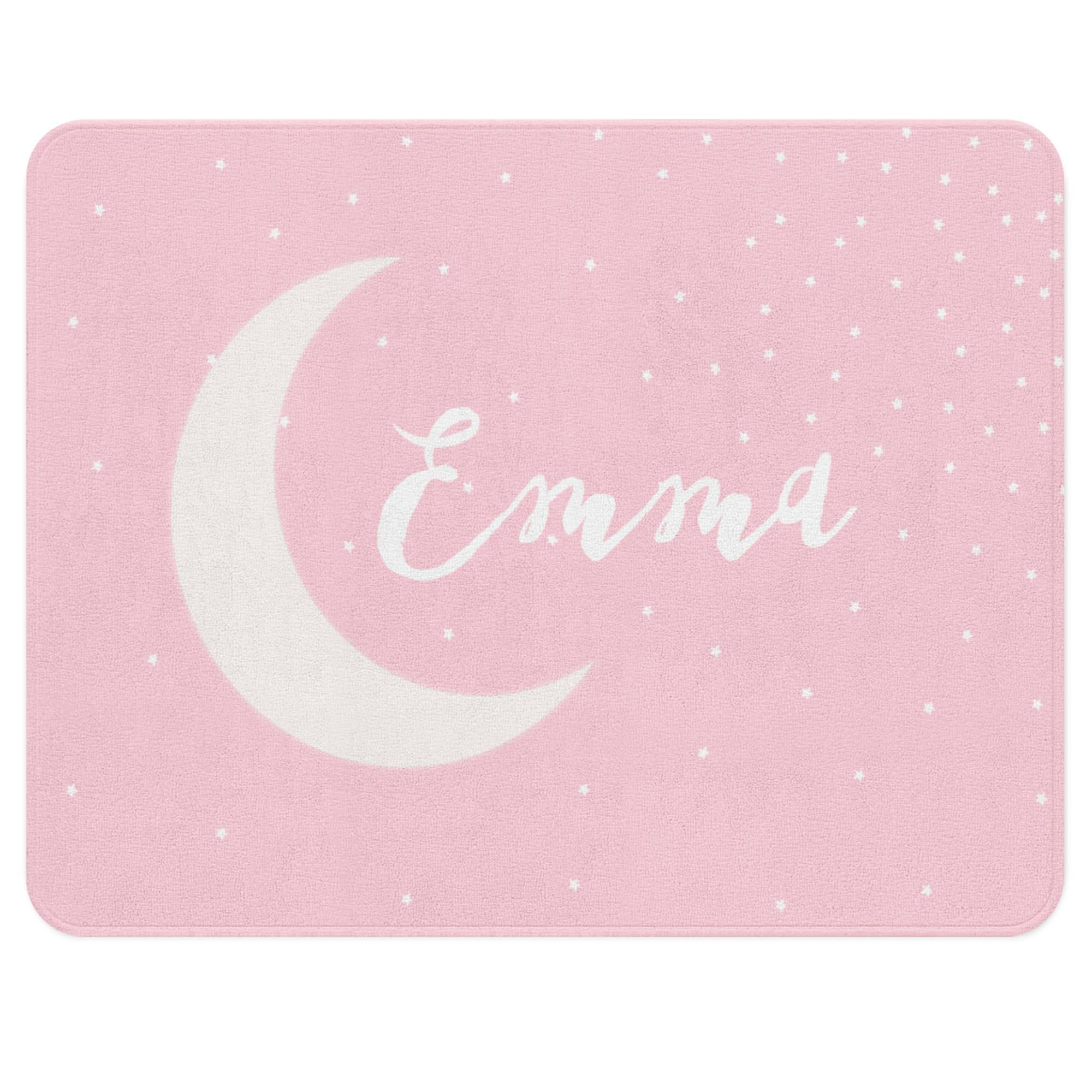 A pink rug with a stars sprinkled all over it. Customize it with your child's name floating gently over the moon in the center. Let this versatile piece add some calm to your little one's nursery.