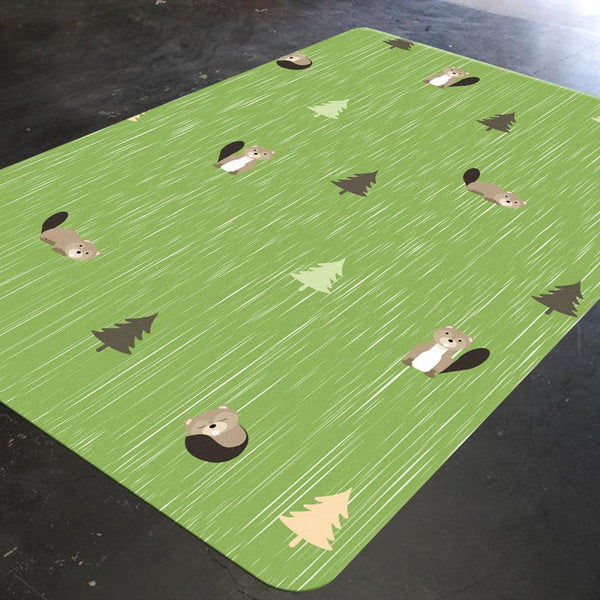 Animal Nursery Rug, grass green background with beavers and pine trees on it.