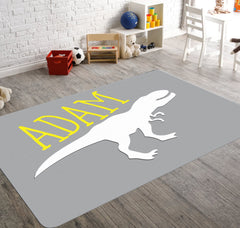 A gray customized rug with a dino silhouette screaming your child's name, will add that jurassic element to your boy's playroom or bedroom.