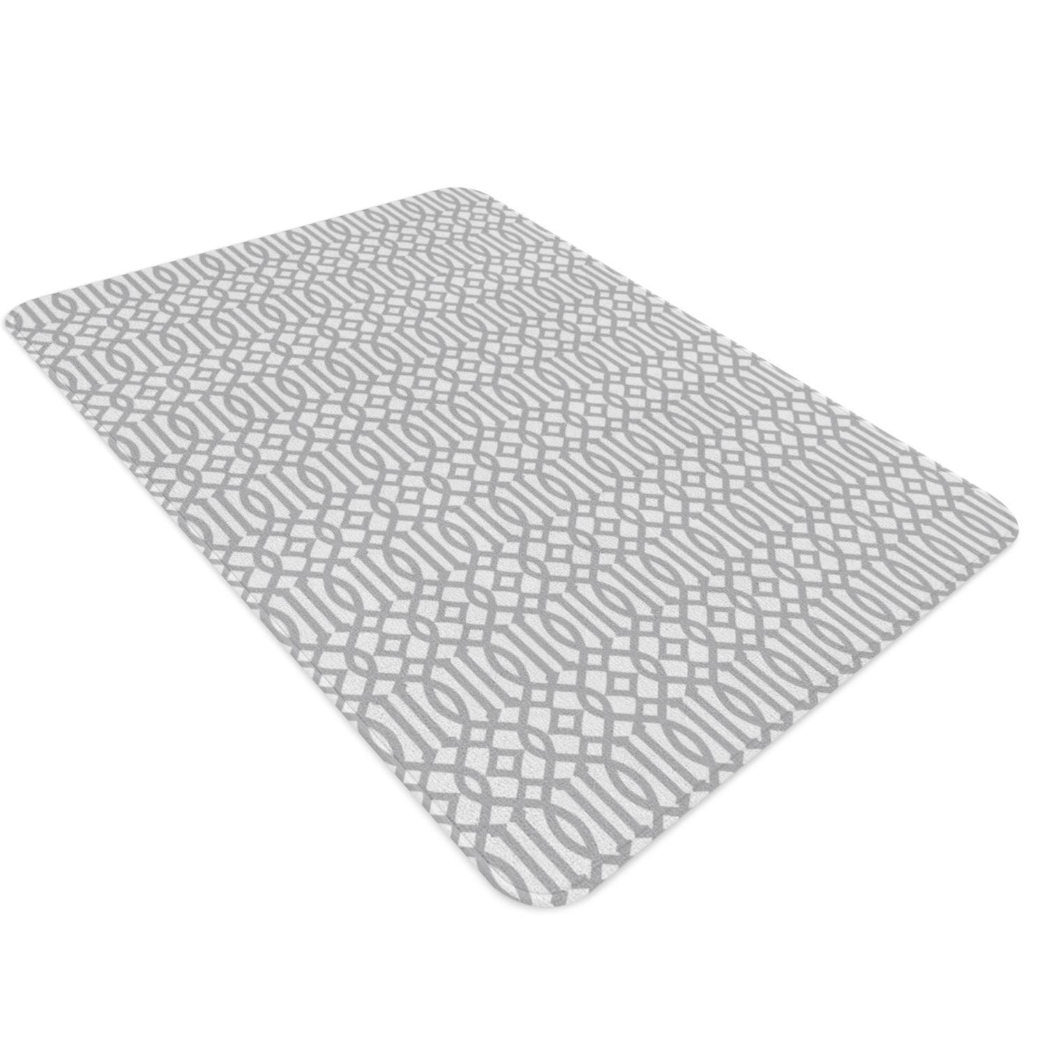 A geometric nursery rug with trellis pattern in gray and white. This monochrome abstract patterned rug is captivating and can easily be the prodigal piece of your nursery.