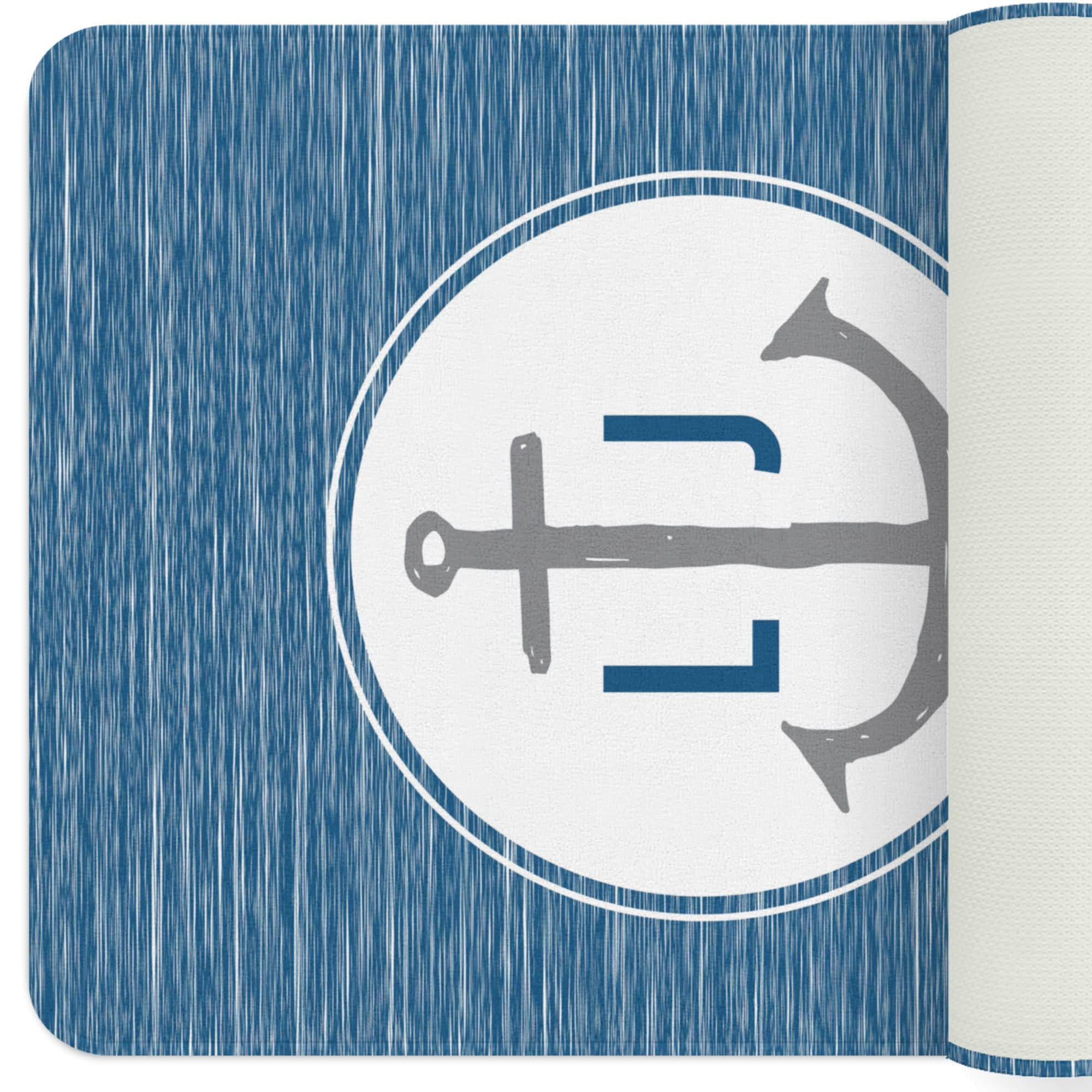 A nautical blue and gray dual monogram rug with an anchor in the center. The monograms lie on either side of the anchor. Customize it to your child's nautical themed nursery!