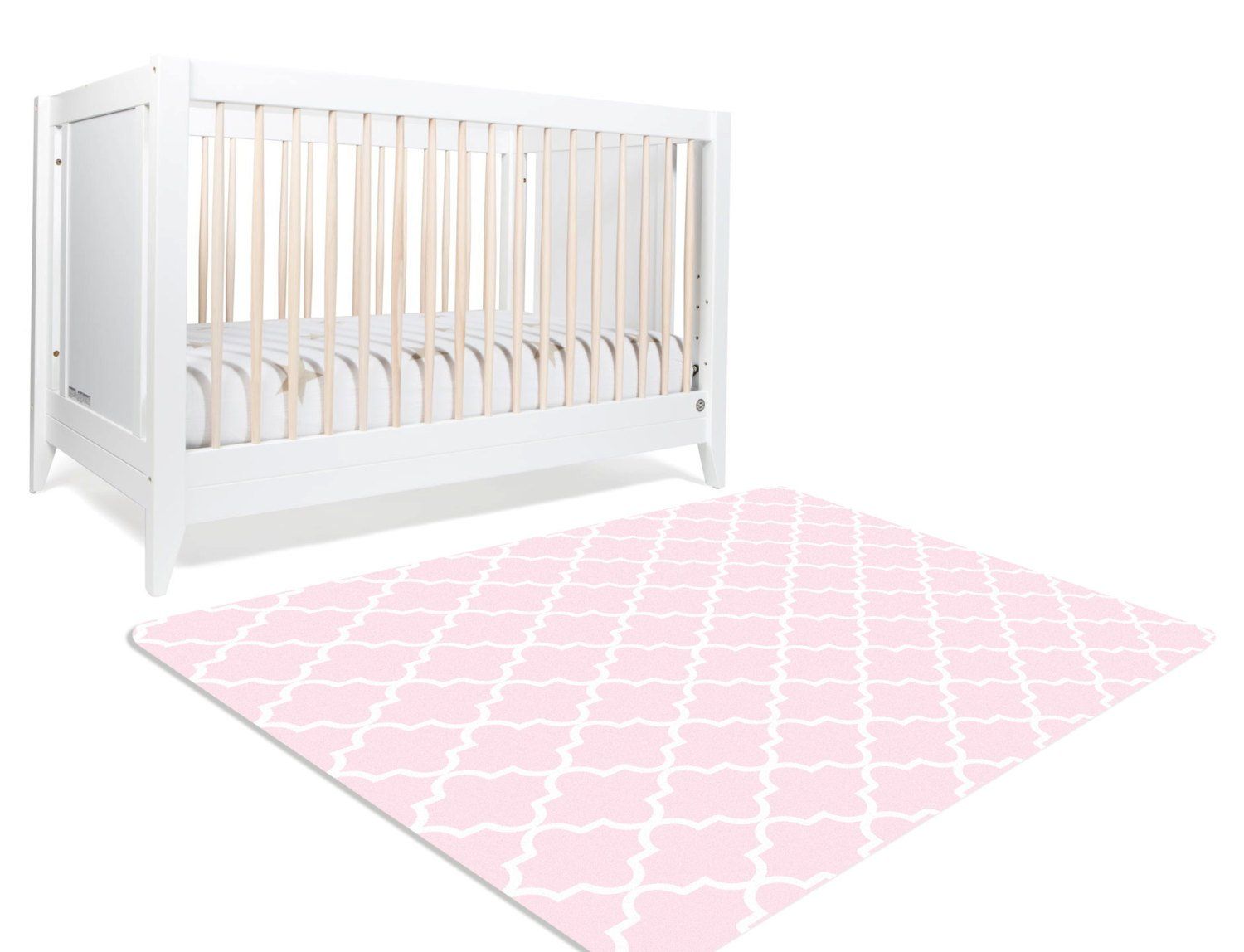 A geometric nursery rug with moroccan trellis design. The white trellis design is on a pink background on the rectangular rug. This nursery rug is perfect for your daughter's princess themed nursery.