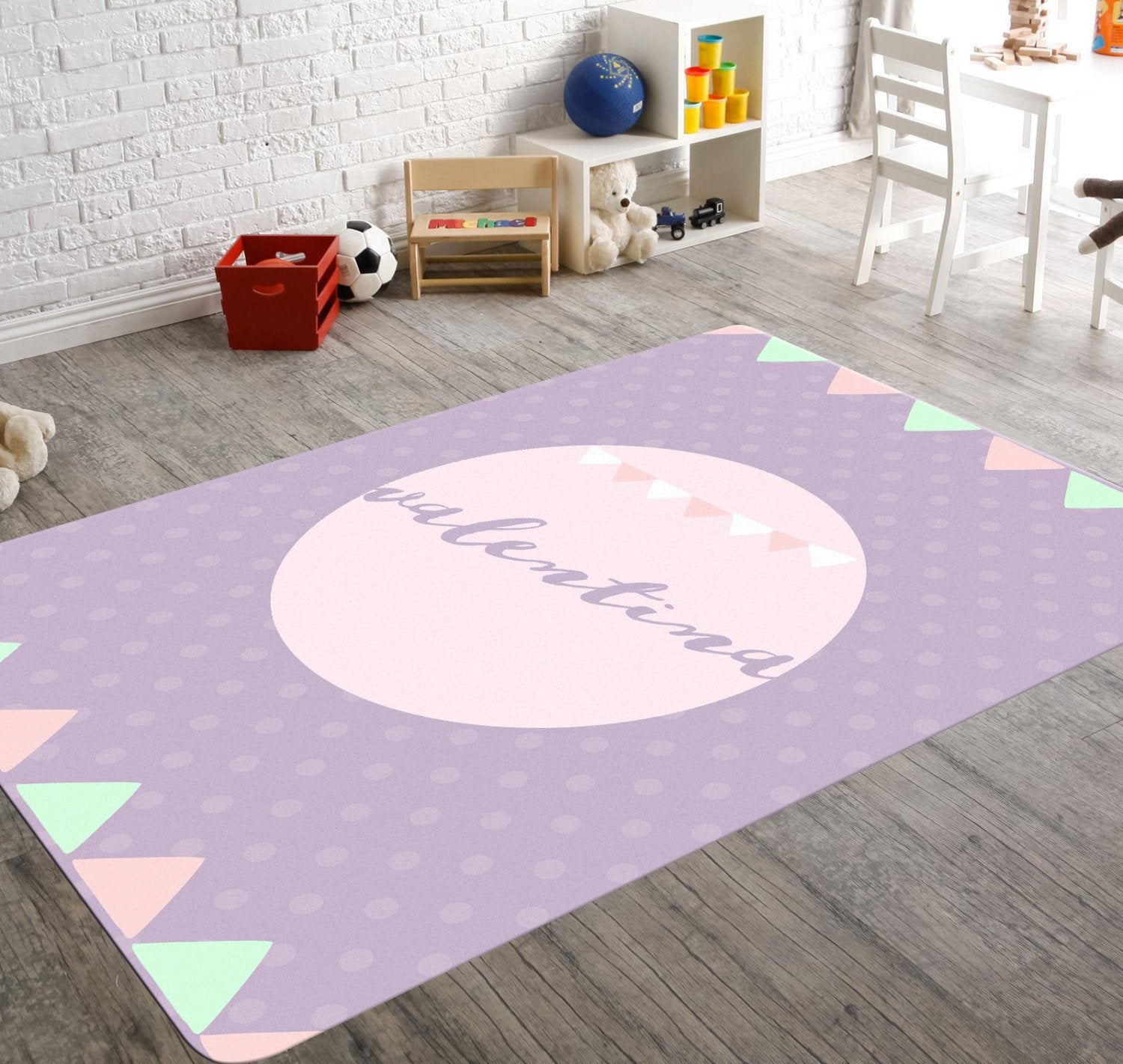 rectangular polka dotted nursery rug with green and pink playful buntings. Shades of lavender in colour and can be personalized.