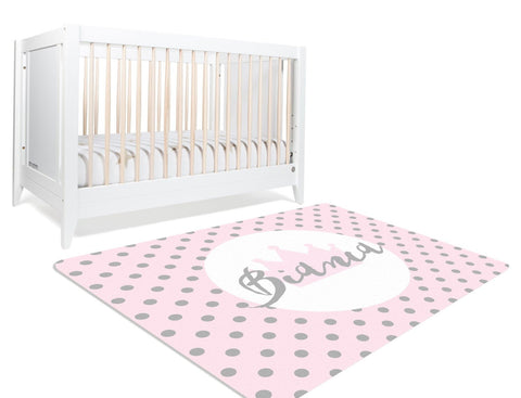 A pink monogram rug with your child's name inscribed on a crown in silver in the center along with silver polka dots. A cute rug perfect for your little girl's princess themed nursery.
