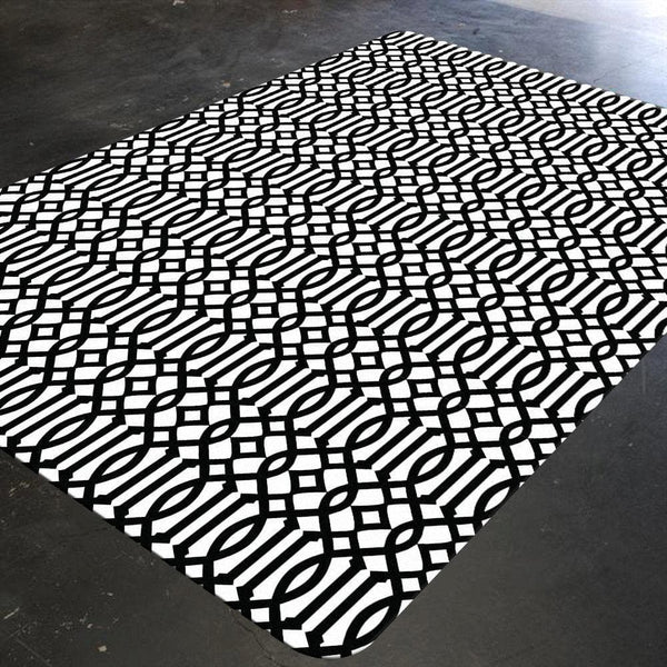 A geometric nursery rug with trellis pattern in black and white. This monochrome abstract patterned rug is captivating and can easily be the prodigal piece of your nursery.