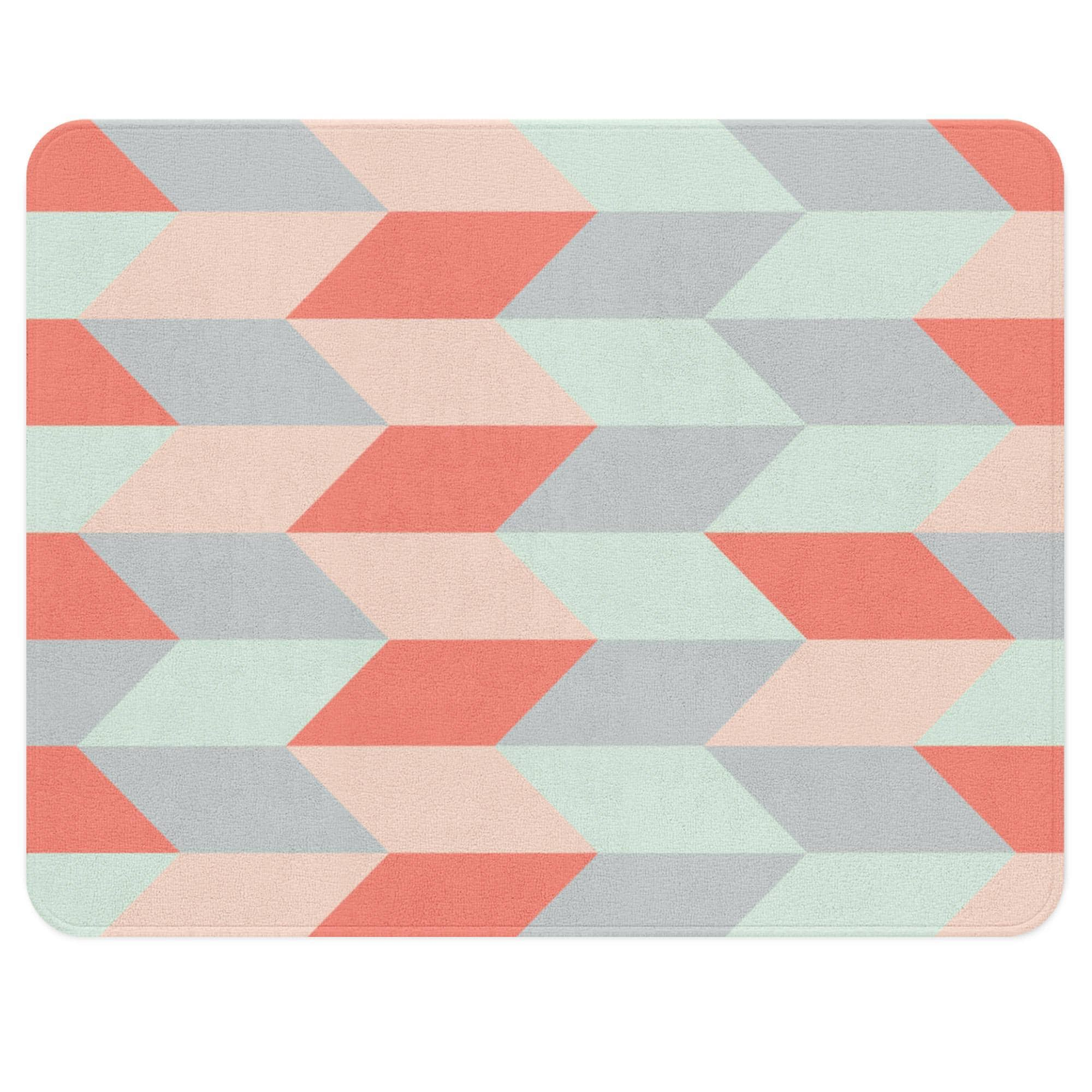A geometric rug with the herringbone pattern. This neutral rug has different colors such as mint, gray, blush and peach. The color scheme gives it an over all neutral and elegant look. This rectangular rug will add some vintage charm to your child's nursery.