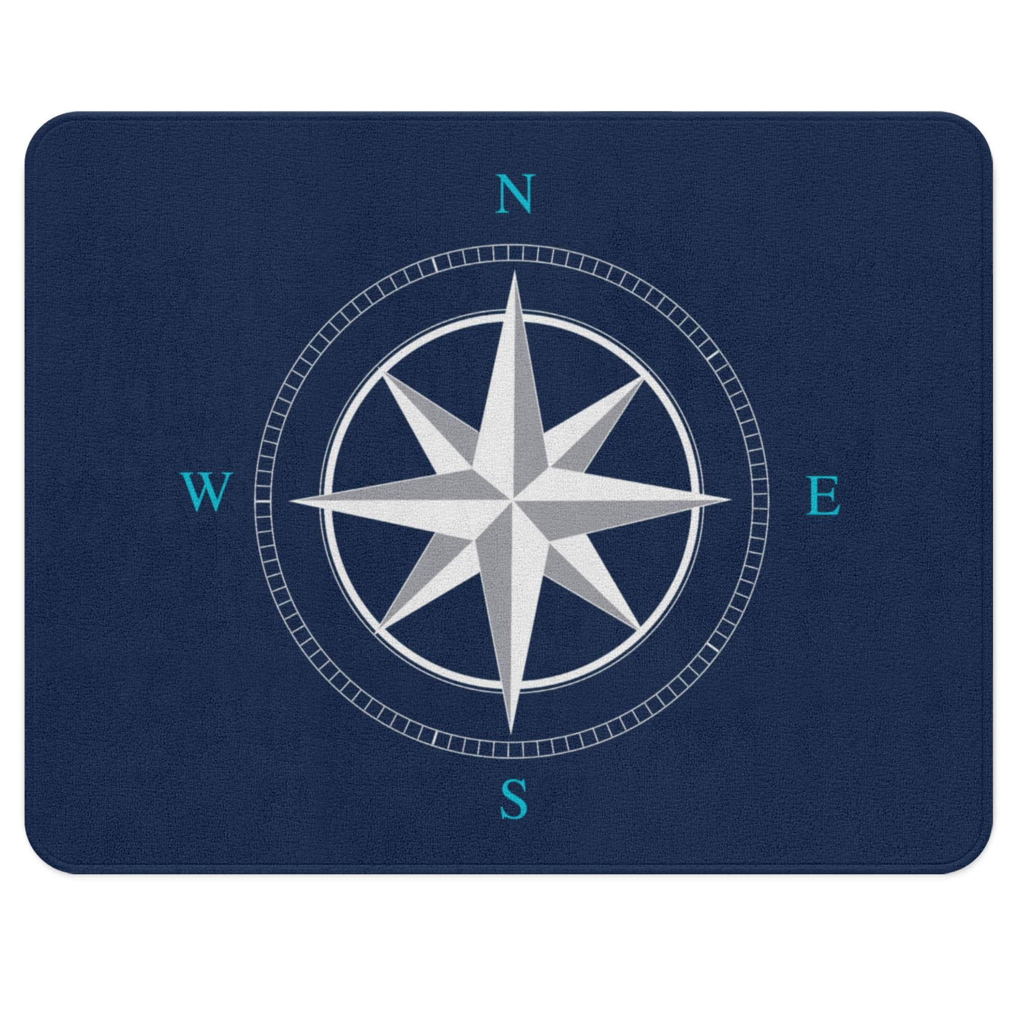 A navy blue nautical rug with a white wind rose in the center. Ideal for your child's nautical themed nursery.