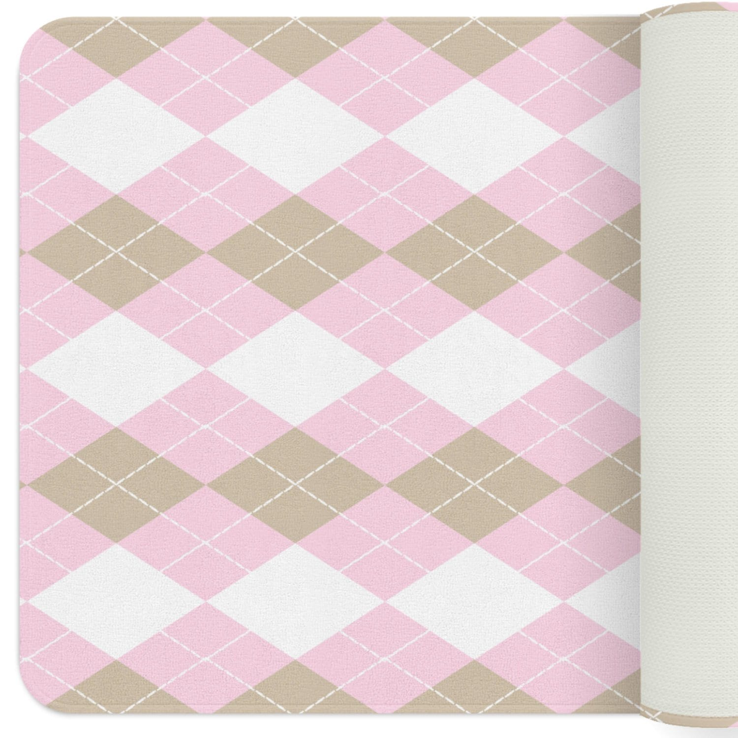 A rectangular rug with argyle pattern. This geometric pattern consists of diamond shapes in pink, white and beige. This argyle patterned rug will go with any nursery theme and will give your baby girl's nursery a sophisticated look.