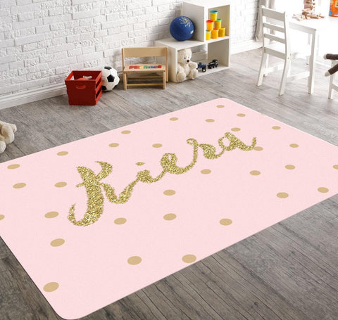 A soft pink nursery rug with golden polka dots. Customize it with your baby girl's name in glitter and add some personality to your daughter's nursery with this fabulous rug.