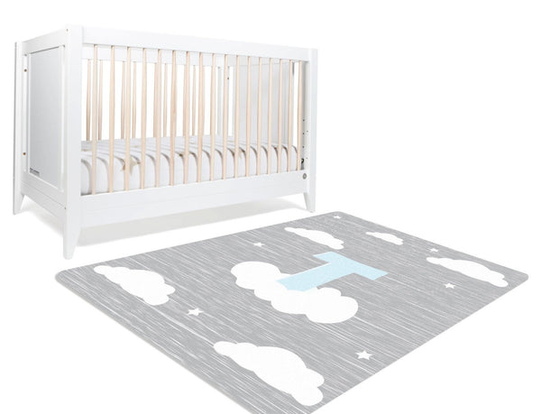 A custom cloud rug for your boy with his initial in pale blue perched on a cloud in a night sky. The gray rug along with a sprinkle of stars is a safe choice for your baby boy's nursery or his playroom.
