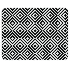 A geometric rug with black and white squares. This monochrome nursery rug with tiled squares gives an optical illusion which is very striking and will add instant drama to your child's modern nursery.