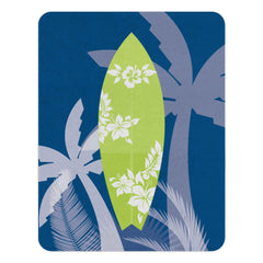 A blue nursery rug with with a green surfboard with silhouettes of hibiscus on it.  The rug also has silhouettes of palm trees around it. This rug is perfect for your beach themed nursery or for your kids playroom.