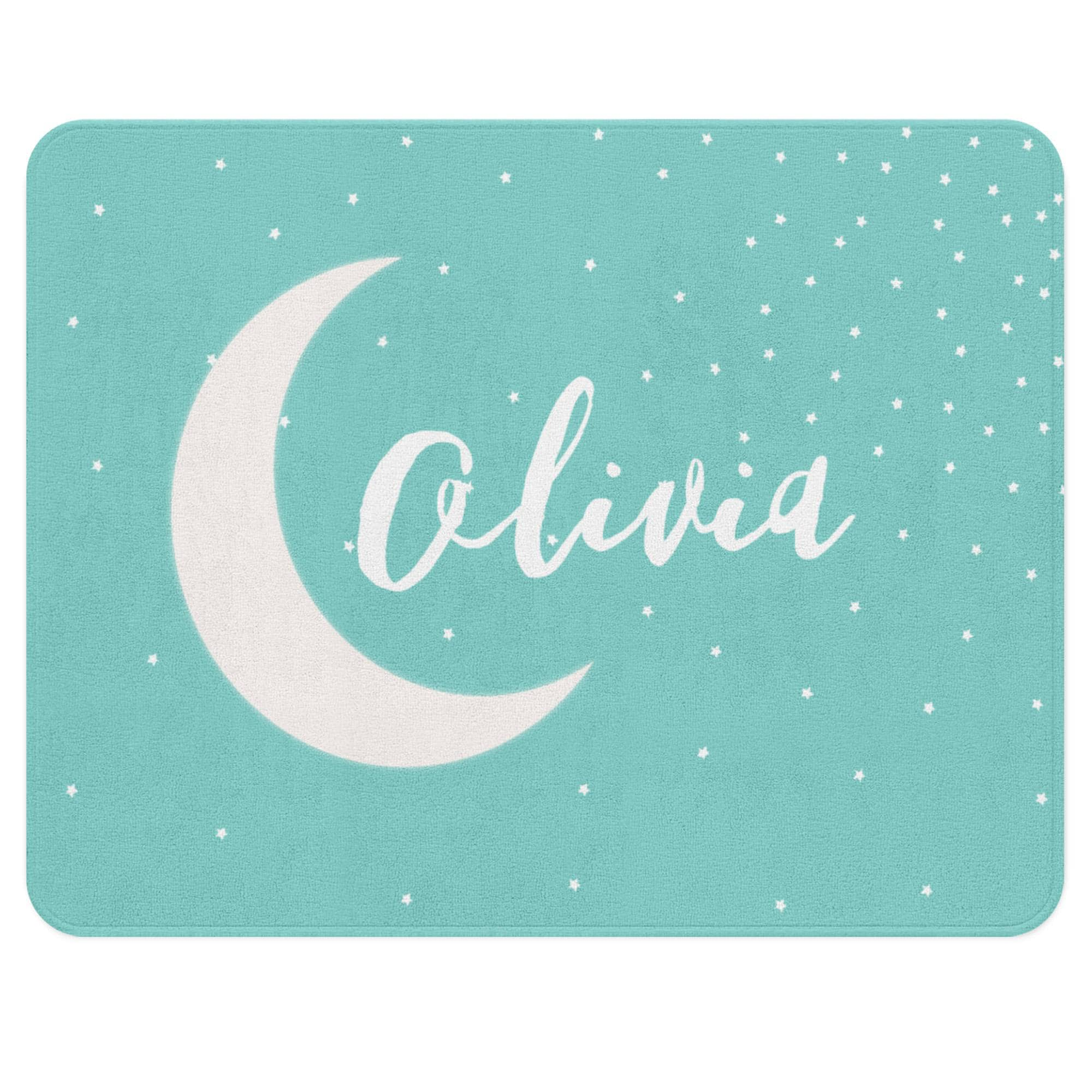 A teal rug with a stars sprinkled all over it. Customize it with your child's name floating gently over the moon in the center. Let this versatile piece add some calm to your little one's nursery.