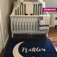 A navy rug with a stars sprinkled all over it. Customize it with your child's name floating gently over the moon in the center. Let this versatile piece add some calm to your little one's nursery.