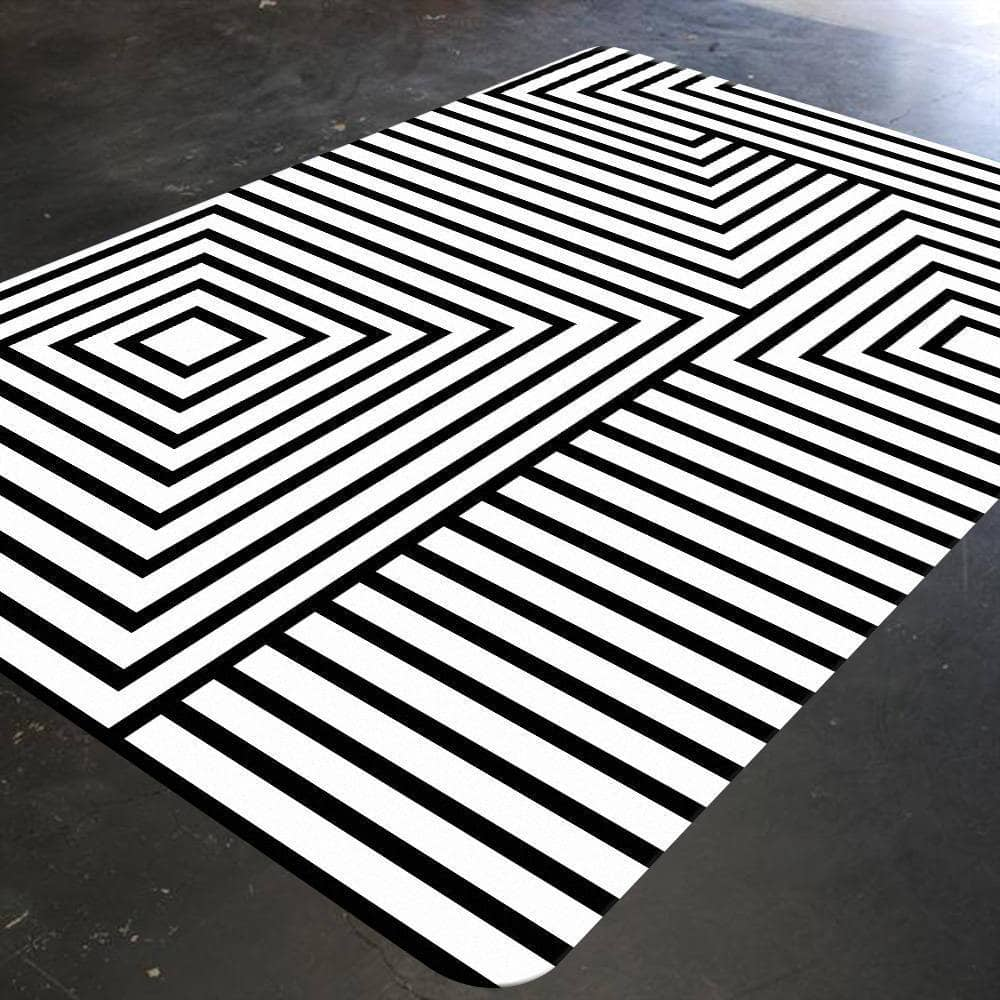 A geometric nursery rug with black and white stripes and squares. This monochrome rug is an illusive and striking at the same time. This rug can be a focal point for your child's nursery.