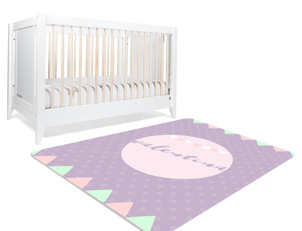rectangular polka dotted nursery rug with green and pink playful buntings.  lavender and peach in colour and can be personalized.